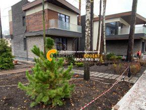 Проект двухэтажного дома с террасой и балконами